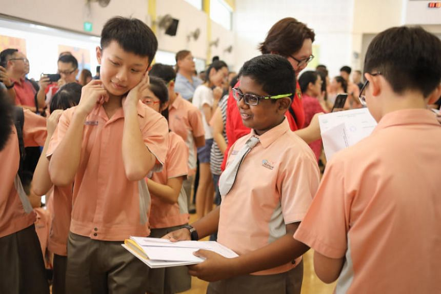 """The Ministry of Education said PSLE scores """"will continue to serve as a good initial gauge of the pace of learning that our students are most suited for at the beginning of Secondary 1""""."""