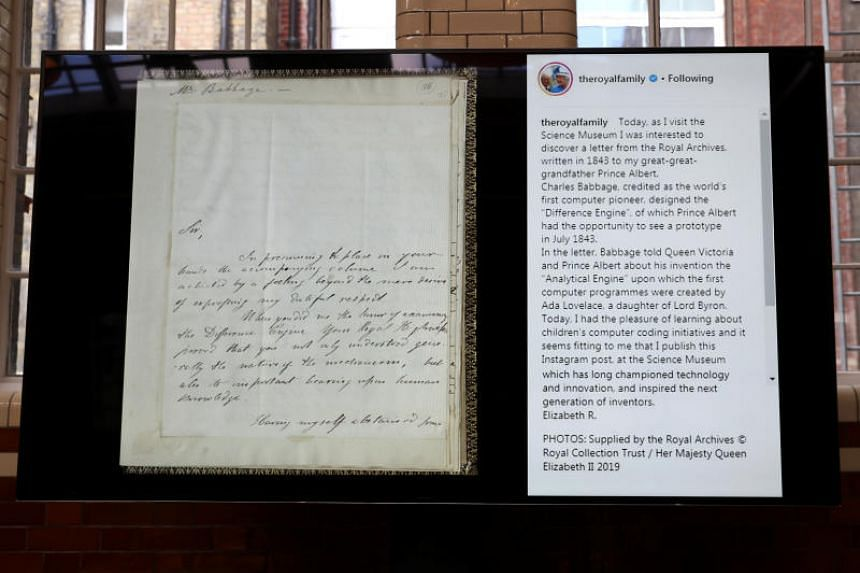 The first Instagram post by Britain's Queen Elizabeth is displayed alongside a letter to Prince Albert, during the Queen's visit to the Science Museum in London on March 7, 2019.