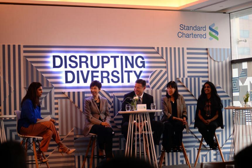 (From left) CNN journalist Manisha Tank, moderator of a discussion organised by Standard Chartered Bank (StanChart) to celebrate International Women's Day, with panellists Mrs Josephine Teo, Minister for Manpower, Mr Simon Cooper, chief executive for