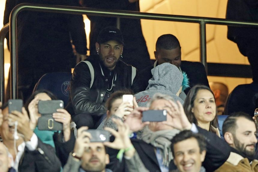 Neymar watches from the stands as PSG play Manchester United in the Champions League.