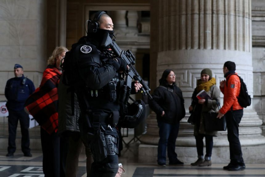 A police special unit officer secures the Palace of Justice during the trial of Mehdi Nemmouche and Nacer Bendrer.