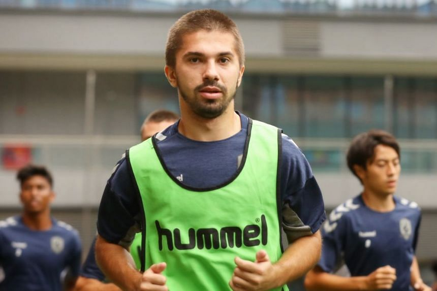 Tampines Rovers' Zehrudin Mehmedovic warms up before a team training session.