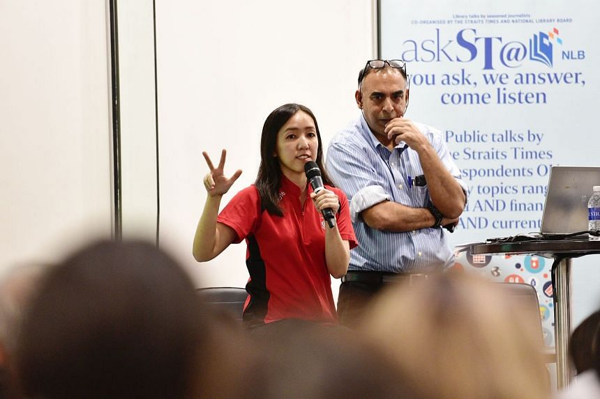 National shooter Jasmine Ser and ST assistant sports editor Rohit Brijnath at the Central Public Library.