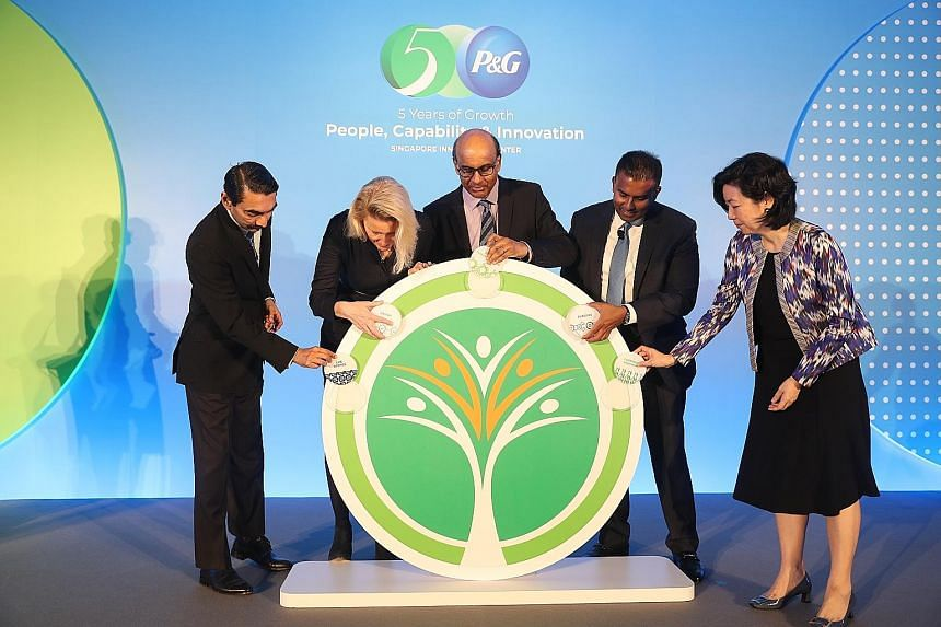 Deputy Prime Minister Tharman Shanmugaratnam was the guest of honour yesterday at the fifth anniversary of P&G's Singapore Innovation Centre, where he was joined by (from left) A*Star managing director Raj Thampuran; Ms Kathy Fish, P&G's chief resear