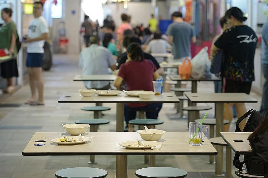 Used crockery left on the tables by patrons at Marsiling Mall hawker centre, one of the three hawker centres in the centralised dishwashing subsidy programme. The stallholders currently get two years of subsidies for centralised dishwashing under the