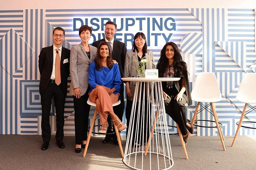 Manpower Minister Josephine Teo (second from left) and CNN journalist Manisha Tank (centre), who moderated the discussion, with (from left) StanChart Singapore CEO Patrick Lee; Mr Simon Cooper, StanChart's chief executive for corporate, commercial an