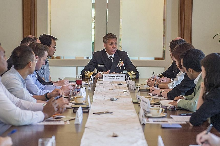 Admiral Philip Davidson, commander of the US Indo-Pacific Command, speaking to reporters at the US Ambassador's residence ahead of his lecture yesterday. He spoke about a free and open Indo-Pacific region, stressing that Singapore remains an importan