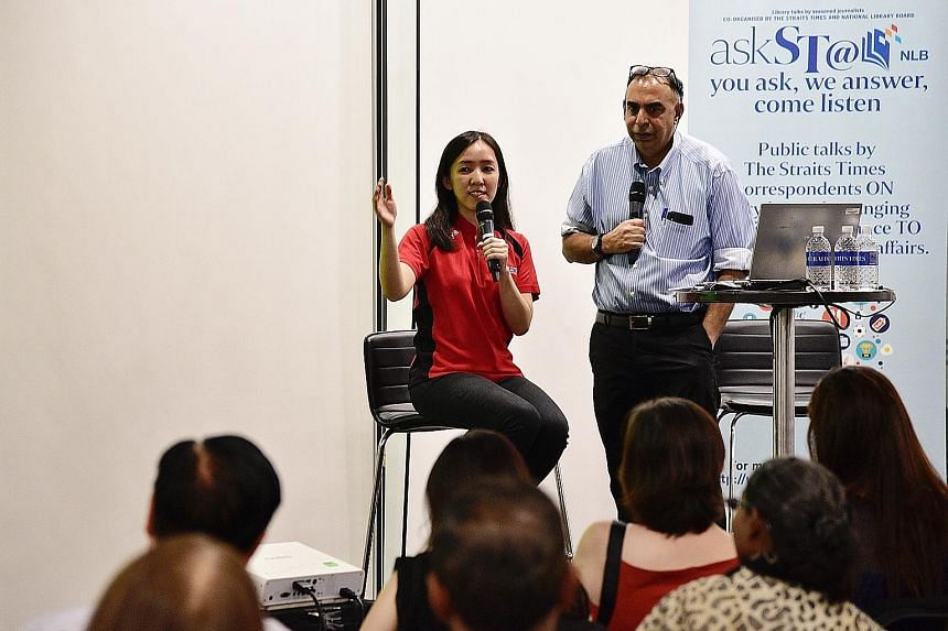 National shooter Jasmine Ser and The Straits Times assistant sports editor Rohit Brijnath speaking at askST@NLB at the Central Public Library yesterday. Ser shared with the 150 readers about the pressures of being an athlete, and also about how she w