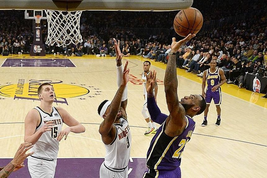 purchase cheap 65e7c 9be9b LeBron James of the Los Angeles Lakers scoring the basket that takes him  past Michael Jordan