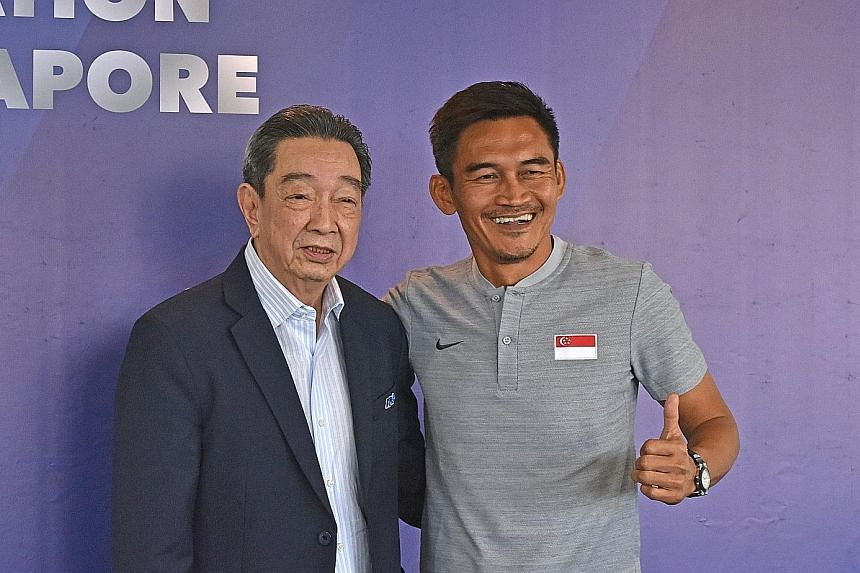 Teo Hock Seng, the FAS vice-president, posing with former captain Nazri Nasir, who will lead the Lions at the AirMarine Cup in Kuala Lumpur on March 20 and 23.