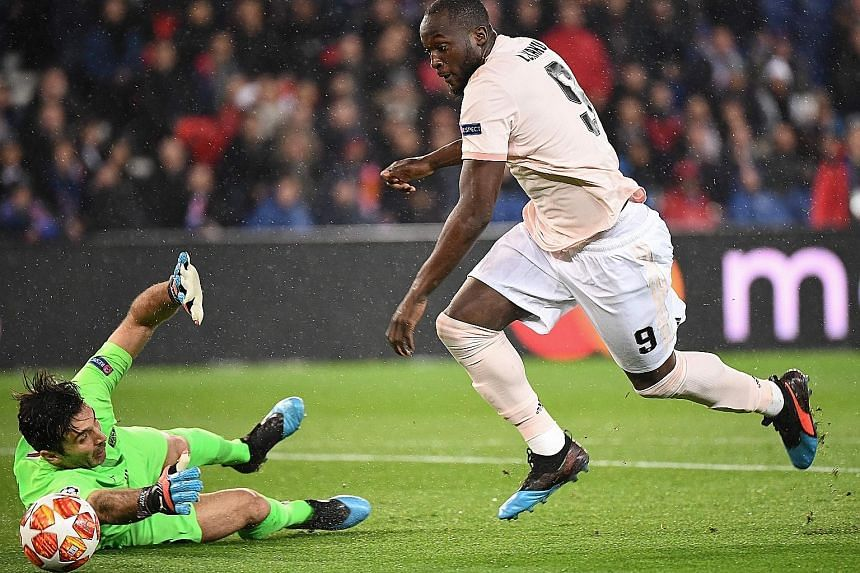 Top: A bad pass by defender Thilo Kehrer letting in Manchester United striker Romelu Lukaku, who rounded Paris Saint-Germain goalkeeper Gianluigi Buffon to score after only 111 seconds. Above: Buffon letting Marcus Rashford's shot slip out of his han