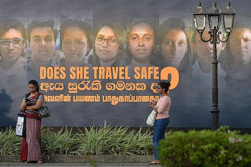 A banner of an International Women's Day photo exhibition in Colombo, Sri Lanka. The United Nations' International Labour Organisation reported that nearly 22 per cent of women - compared with only 1.5 per cent of men - of working age worldwide perfo