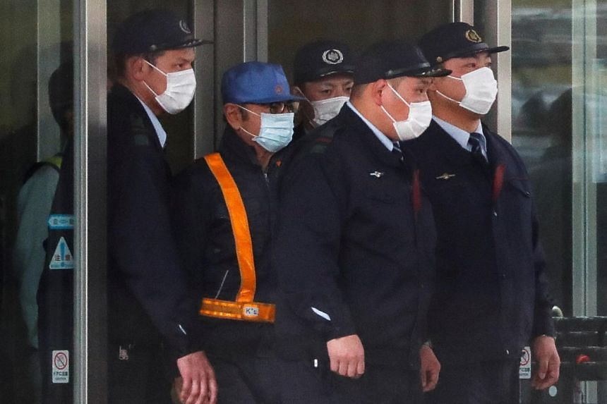 Former Nissan Motor Chairman Carlos Ghosn (wearing blue cap) leaves the Tokyo Detention House in Tokyo, Japan, on March 6, 2019.