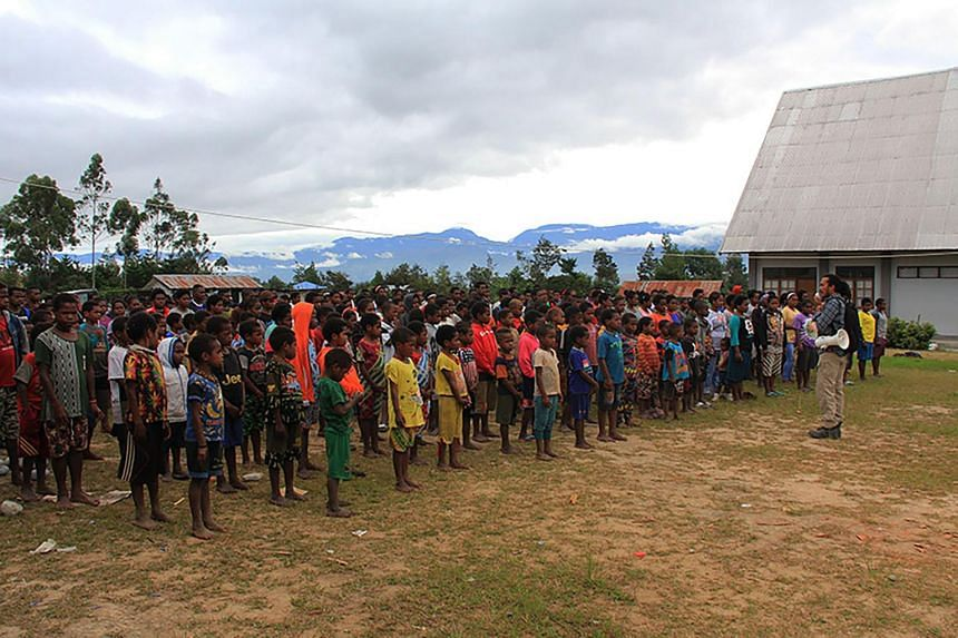 Papuan children gathering at a temporary shelter in Wamena, Indonesia's Papua province, on Feb 12, 2019.