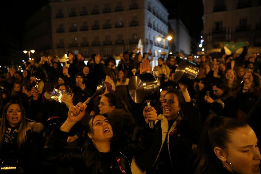 Women bang pots and pans during a protest at the start of a nationwide feminist strike on International Women's Day at Puerta del Sol Square in Madrid, Spain on March 8, 2019.