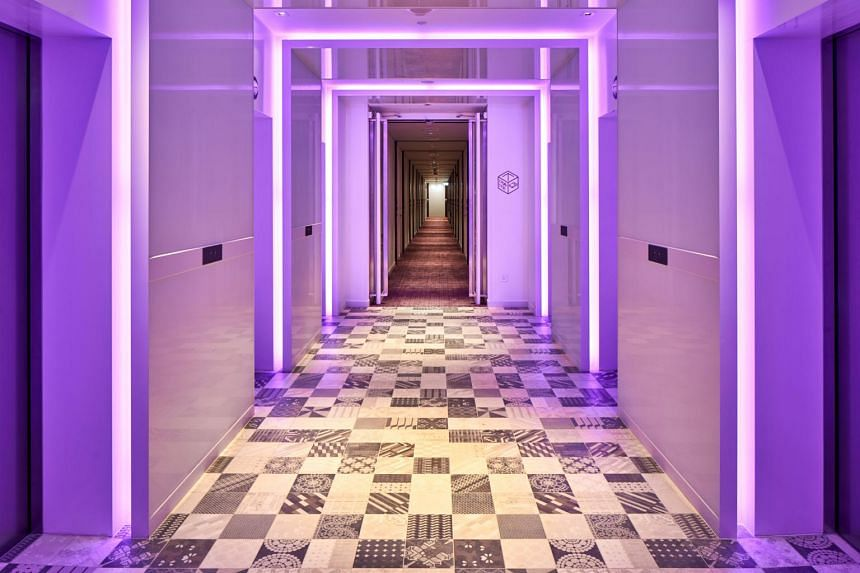 The lift lobby at Yotel Singapore in Orchard Road. YotelAir Singapore Changi Airport will have, in addition to airline-style self check-in kiosks, a 24/7 gym, co-working space and a club lounge that overlooks Jewel's indoor waterfall.