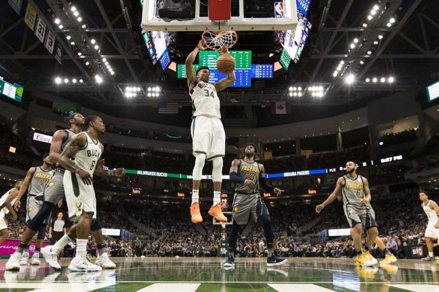 Milwaukee Bucks forward Giannis Antetokounmpo (centre) dunks during the fourth quarter against the Indiana Pacers at Fiserv Forum on March 7, 2019.