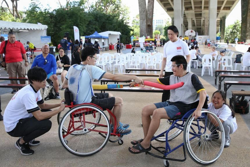 Participants at Let's Play! At Passion Wave@Marina Bay, Pek Dewei (left) and Oh Fu Quan, trying out wheelchair fencing on Jan 12, 2019.