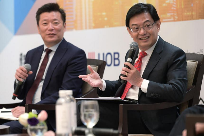 Finance Minister Heng Swee Keat speaks while Lianhe Zaobao and Lianhe Wanbao editor Goh Sin Teck looks on during an annual post-Budget forum organised by Lianhe Zaobao on March 8, 2019.