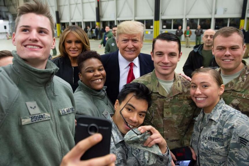 US President Donald Trump and First Lady Melania Trump with members of the US military at Ramstein Air Base in Germany on Dec 27, 2018.