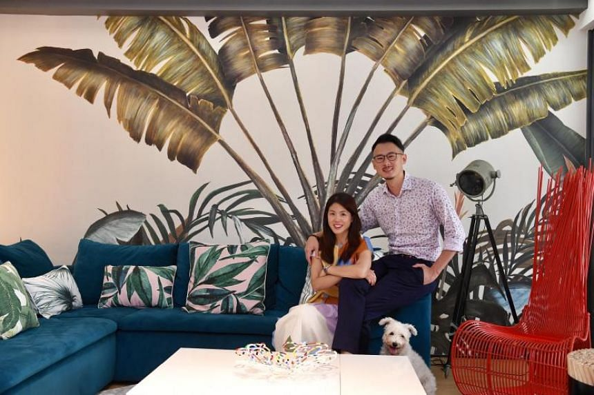 Ms Frances Yeap and her husband Darrell Ee in the living room of their Bukit Timah home. The couple have decorated parts of their three-storey semi-detached house with wallpaper.