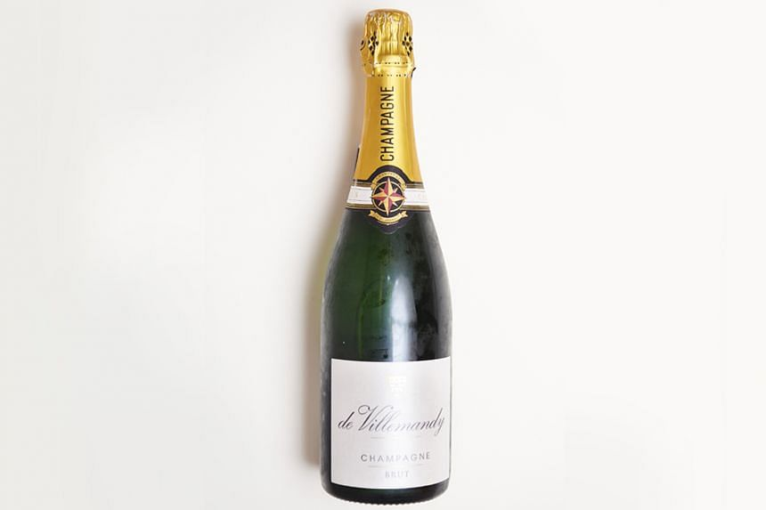 A bottle of champagne, left behind in a duty-free bag. PHOTO: TED CHEN