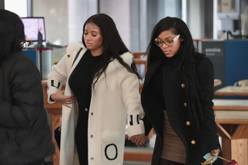 Jocelyn Savage (left) and Azriel Clary arrive for a bond hearing for R. Kelly in Chicago, Illinois.
