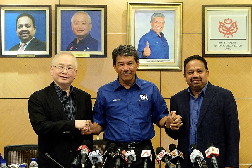 """From left: MCA president Wee Ka Siong, Umno deputy president Mohamad Hasan and MIC president S. A. Vigneswaran after yesterday's meeting. MCA and MIC on Monday said they were looking at forming a new alliance, and were """"moving on"""" from Umno."""
