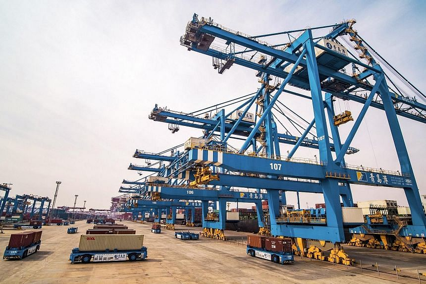 A port in Qingdao in China's Shandong province. February exports fell 20.7 per cent from a year earlier, the largest fall since February 2016, Customs data showed yesterday.