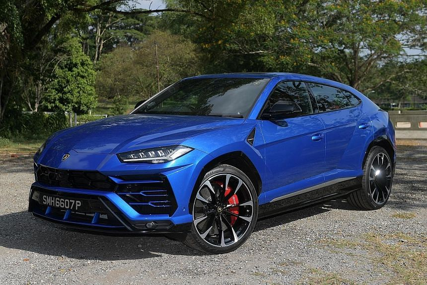 (Top) The Lamborghini Urus is equipped with wireless phone-charging, head-up display and adaptive cruise control. (Above) This is the biggest boot you will find in a Lambo.