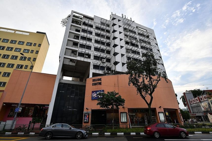 The mixed development consisting of 33 shops and 25 flats has been sold to Peak Tower Corp, which expects to build a hotel or commercial complex there.