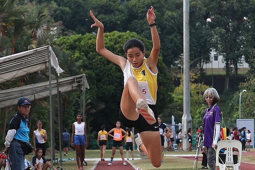Nanyang Girls' Ann Lee jumped a personal best of 11.46m to win the gold in the triple jump.