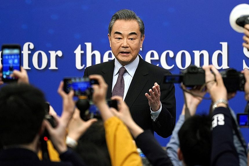 """Speaking at a media conference yesterday on the sidelines of China's annual parliamentary meetings, Foreign Minister Wang Yi urged greater cooperation rather than competition with the US, adding that Beijing hopes Washington will """"abandon its zero-su"""
