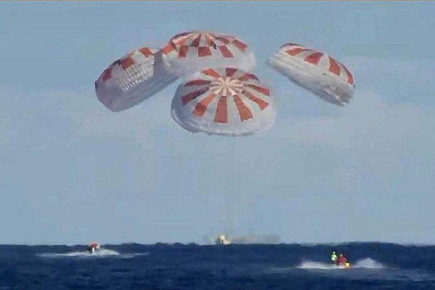 A still image from Nasa TV showing the SpaceX Dragon capsule splashing down in the Atlantic Ocean yesterday. It was the first time a space vessel capable of carrying people had been launched by the US in eight years.
