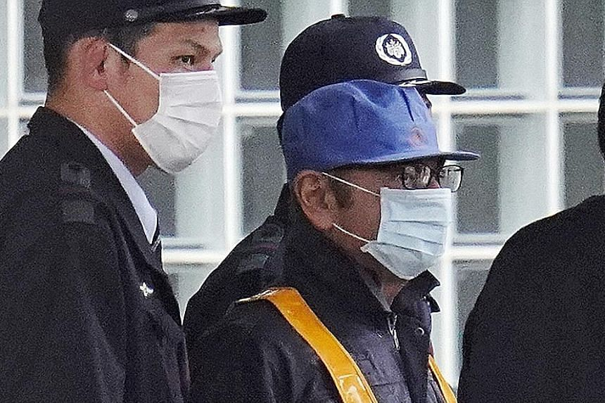 Lawyer Takashi Takano (above) said he had hoped that the disguise would stop the media on Wednesday from tracking Carlos Ghosn (left) to his court-designated residence.