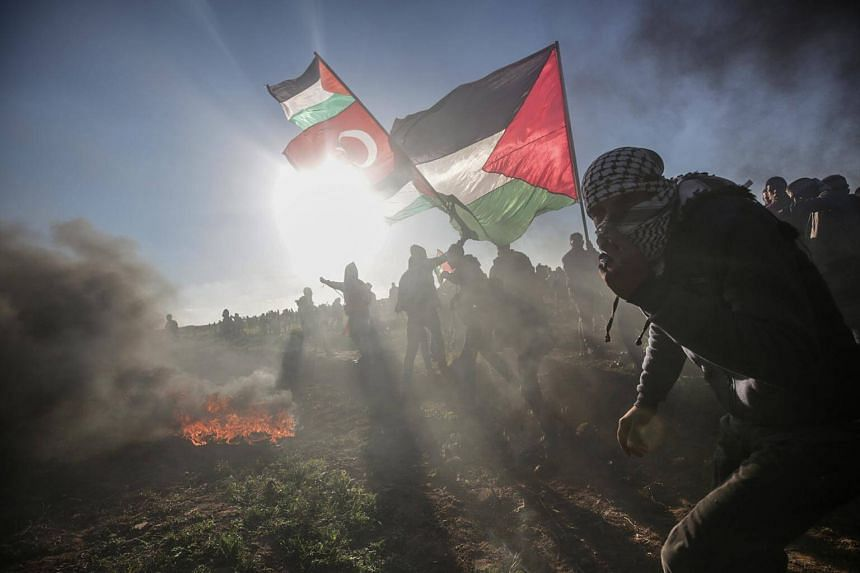 Palestinian protesters in the clash with Israeli forces near the border between Israel and the Gaza Strip, on March 8, 2019.