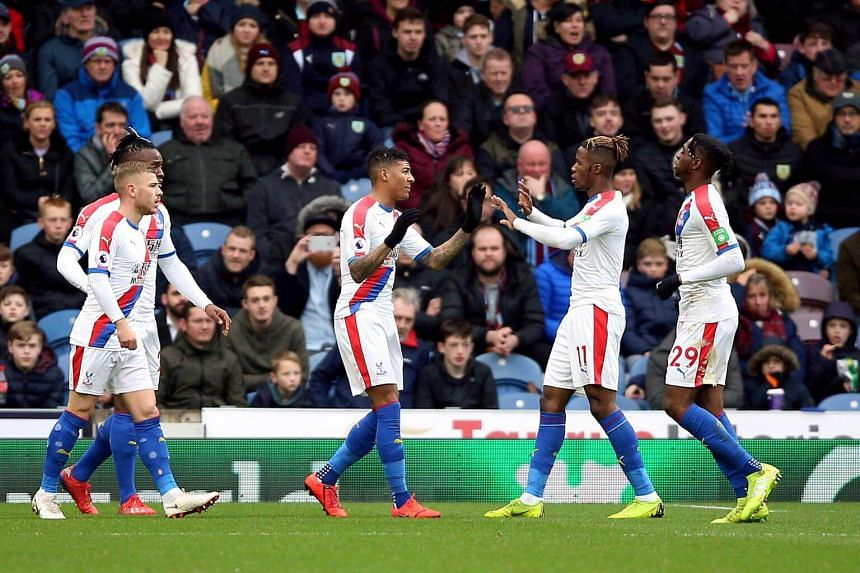 Crystal Palace players celebrate an own goal during the English Premier League soccer match between Burnley and Crystal Palace, on March 2, 2019.