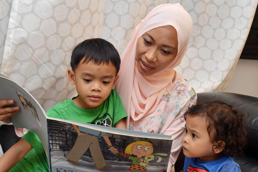 Ms Shamsiah Samsudin reads her children's favourite books to her sons Adyan Darius Juffrey and Adam Mika Juffrey repeatedly as part of her strategy to teach them how to read.