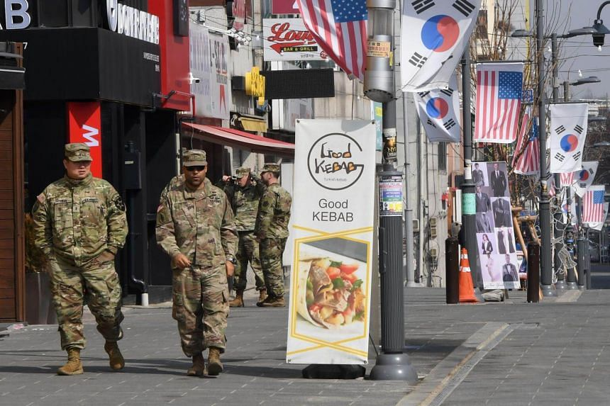 US soldiers walking at a shopping zone outside the US Camp Humphreys in Pyeongtaek, South Korea, on Feb 21, 2019.