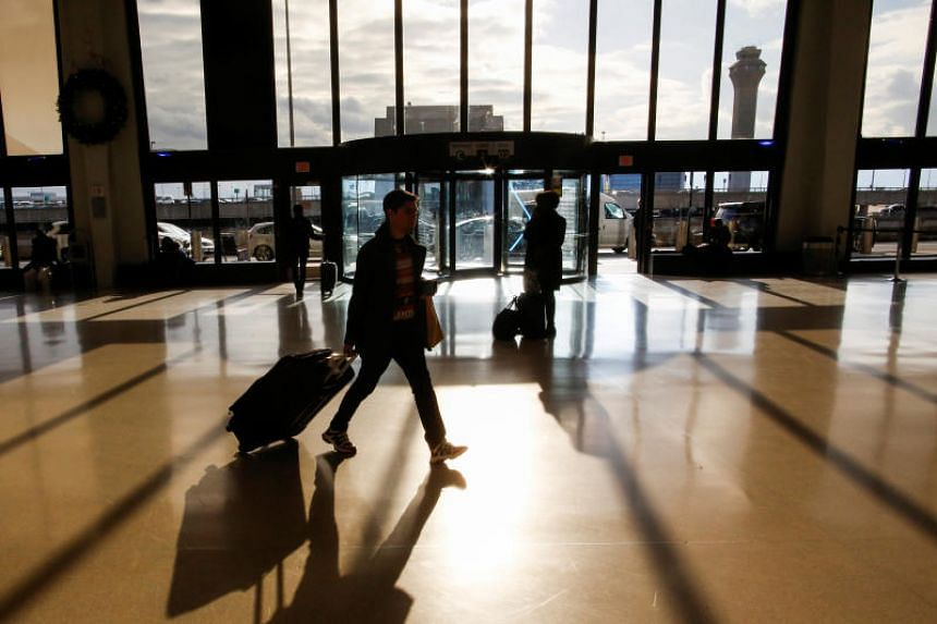 Travellers make their way through Newark Liberty International Airport in Newark, New Jersey, US, on Dec 24, 2018.