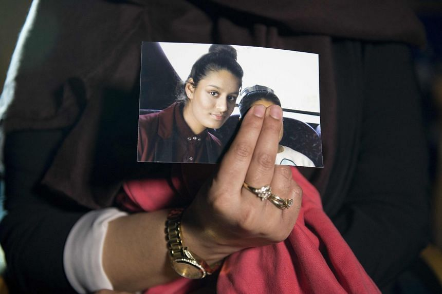 Renu Begum holds a photo of her sister Shamima while being interviewed by the media in London.