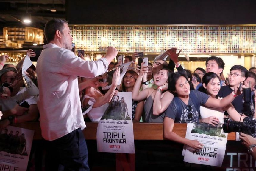 Triple Frontier star Ben Affleck with fans at the Digital Light Canvas at The Shoppes at Marina Bay Sands on March 8, 2019.