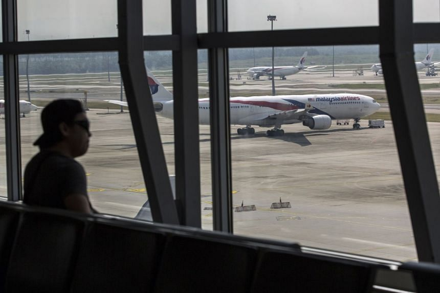 A Malaysia Airlines aircraft seen from a viewing gallery at the Kuala Lumpur International Airport on March 8, 2019.