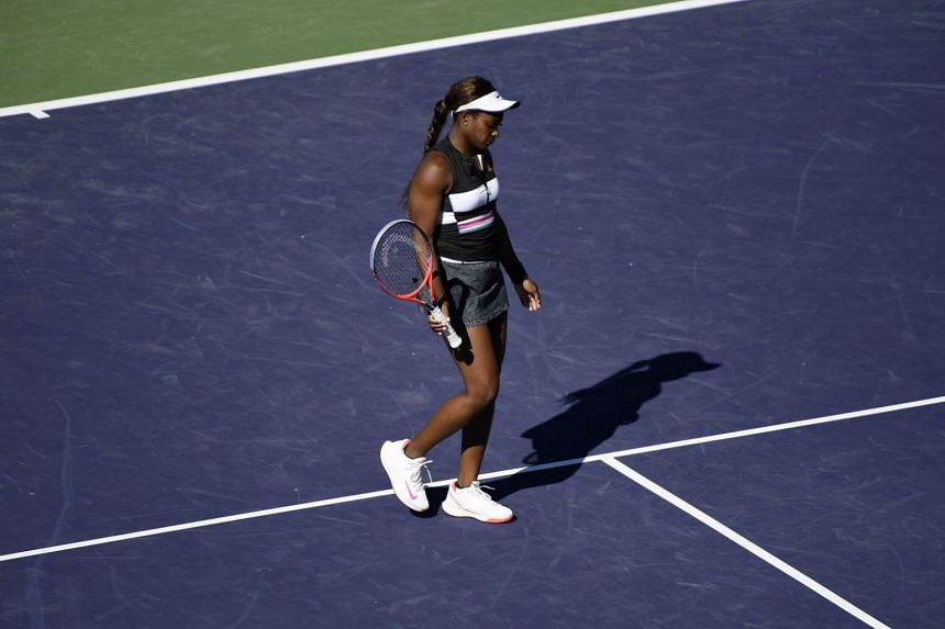 Sloane Stephens walks off the court after getting eliminated by Stefanie Voegele at the BNP Paribas Open, on March 8, 2019, in Indian Wells, California.