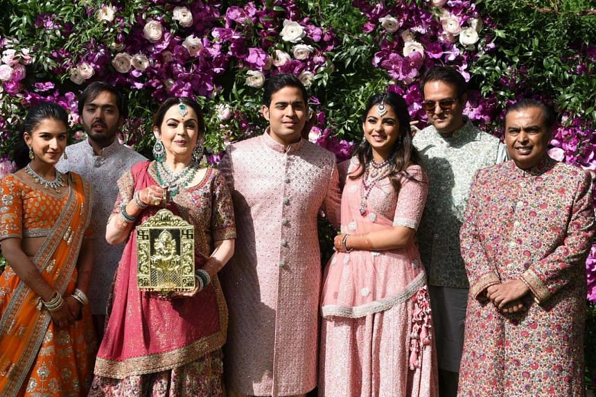 Akash Ambani (centre), son of Indian businessman Mukesh Ambani (far right) posing for a photo with family members during his wedding ceremony, on March 9, 2019.
