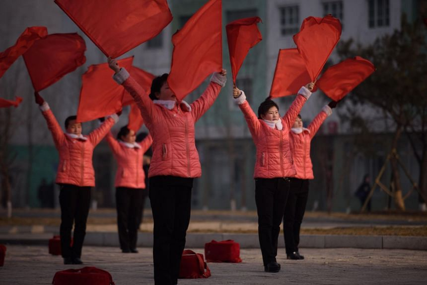 To the sound of patriotic songs extolling the Democratic People's Republic of Korea and lauding its leader Kim Jong Un, detachments of women wave banners and beat red drums for up to an hour.