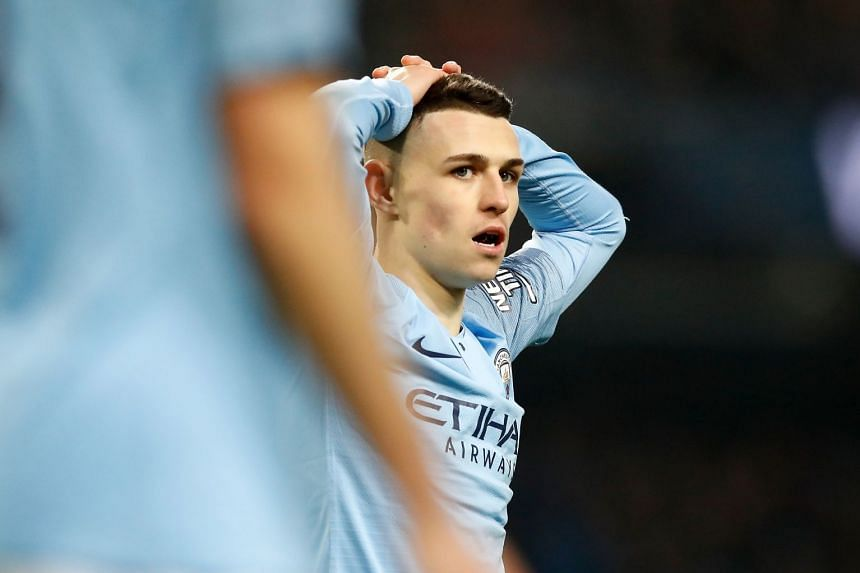 Manchester City's Phil Foden reacts during a match.
