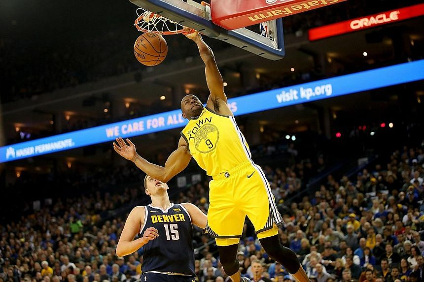 Golden State Warriors guard Andre Iguodala dunking the ball against the Denver Nuggets at the Oracle Arena on Friday night. The Warriors (45-20) won 122-105 to increase their lead over the Nuggets (43-22) in the play-off race.
