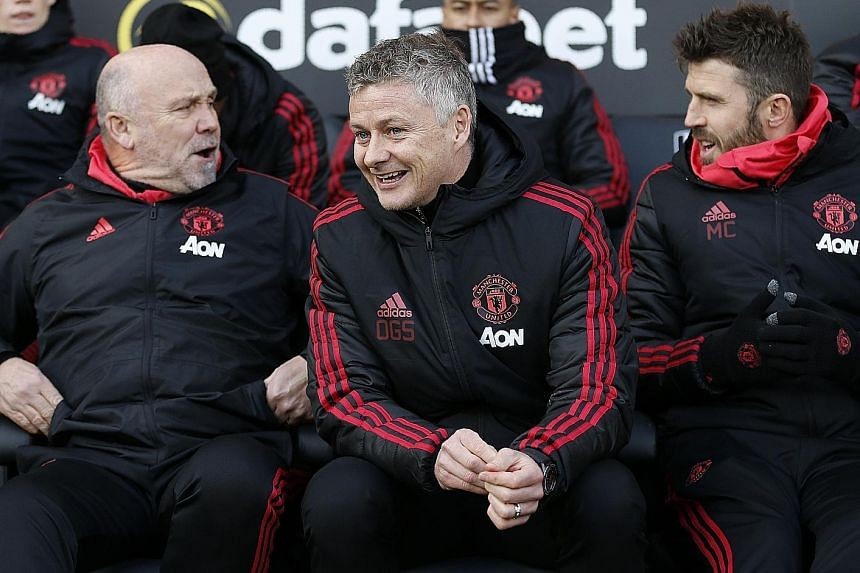 From top: Ole Gunnar Solskjaer showing his considerable motivational skills in consoling United's Spanish midfielder Juan Mata, who went off injured in the 0-0 home draw with Liverpool in the Premier League last month. The United caretaker boss has a