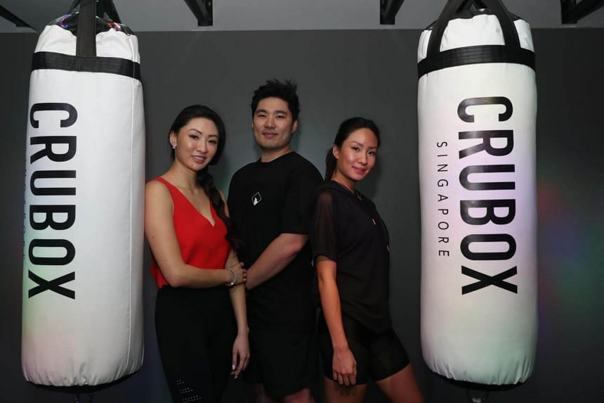 (From left) Siblings and co-founders of CruBox and CruCycle Valerie Ding, Calvin Ding, and Bebe Ding.